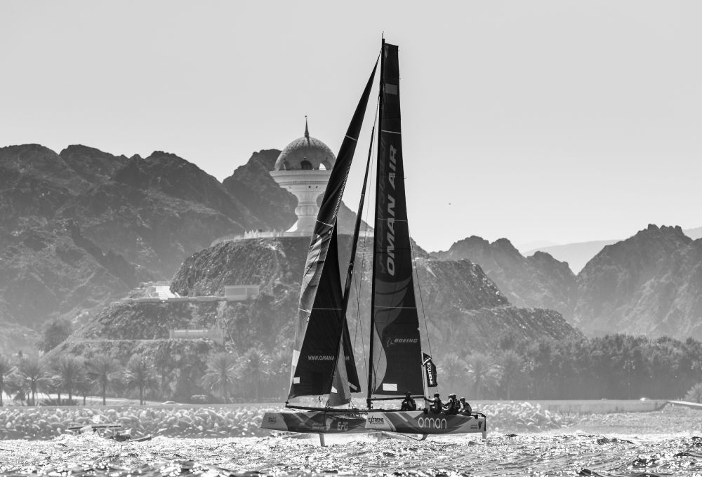 The Extreme Sailing Series 2017. Muscat. Oman. Pictures of the fleet racing close to the shore and historic town of Mutrah Credit - Lloyd Images